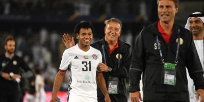 Romarinho félicité par Henk ten Cate (photo Fifa.com)